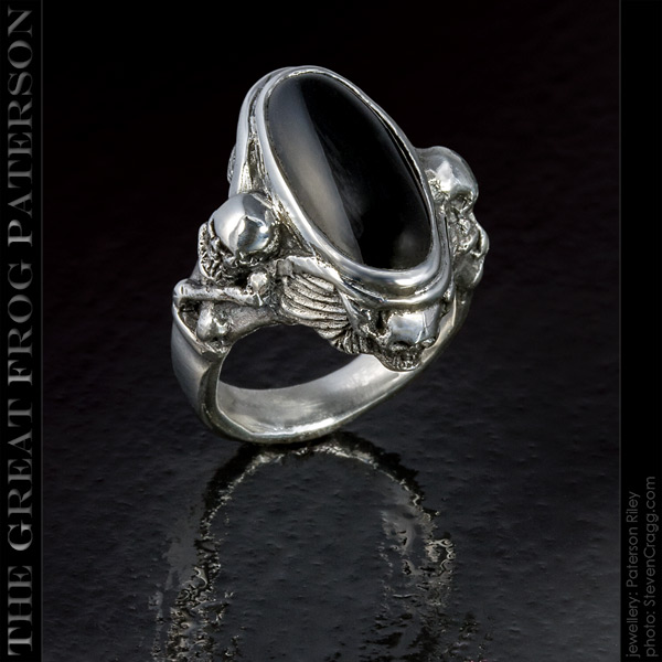 4 skulls silver gemstone ring